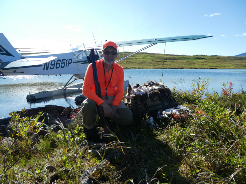 Me with a limit of birds in front of the Super Cub.  The cover in the background shows some of the easiest walking you could ask for in ptarmigan hunting.