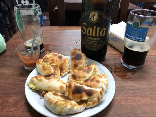 A sampling of empanadas from El Patio de Empanadas in Salta. These were the best beef empanadas that we tasted. The cheese - not so much. Note the red tomato salsa in the drink glass at left rear.