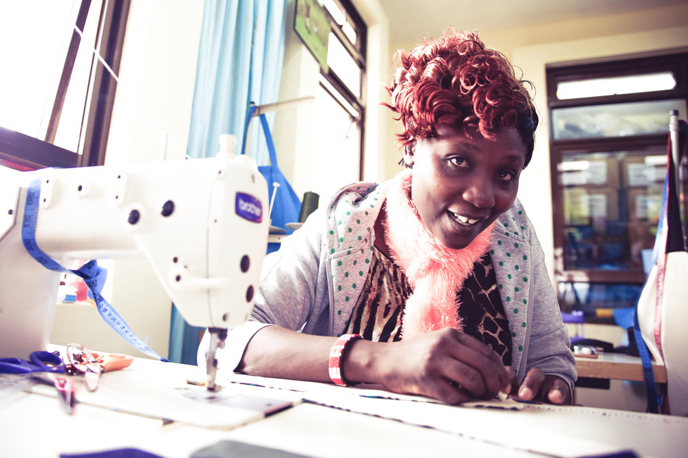 "Empowered employment: an Ubuntu Life ""maker mum"" handcrafts beautiful wares from Maai Mahiu, Kenya. She earns an above-market wage + benefits while generating revenue that supports the special needs center where her child thrives."