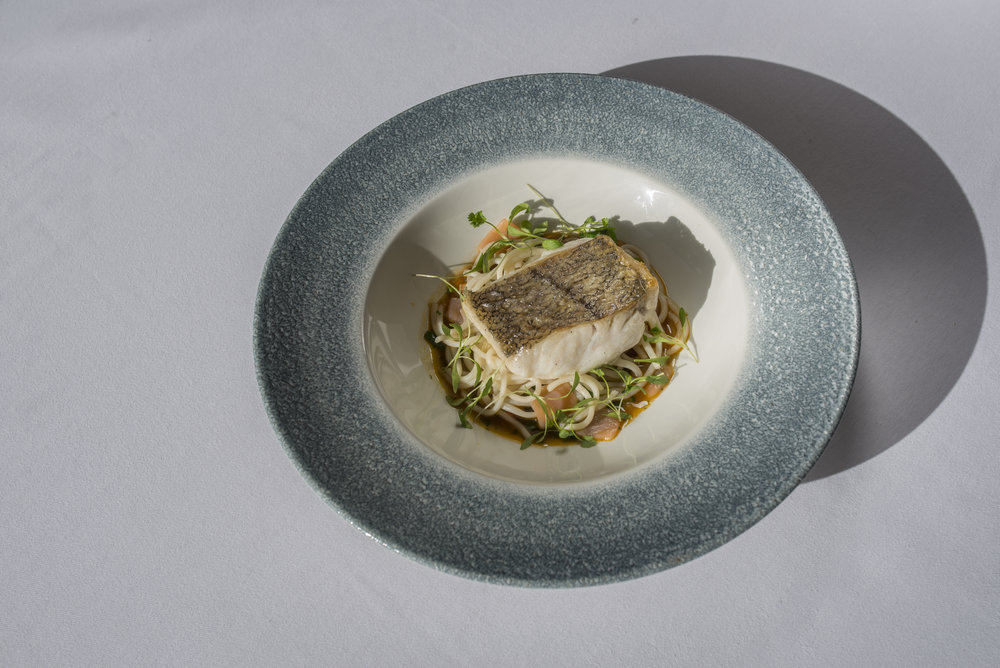 Roast cornish hake, noodles, smoked salmon and winter vegetable Asian broth.