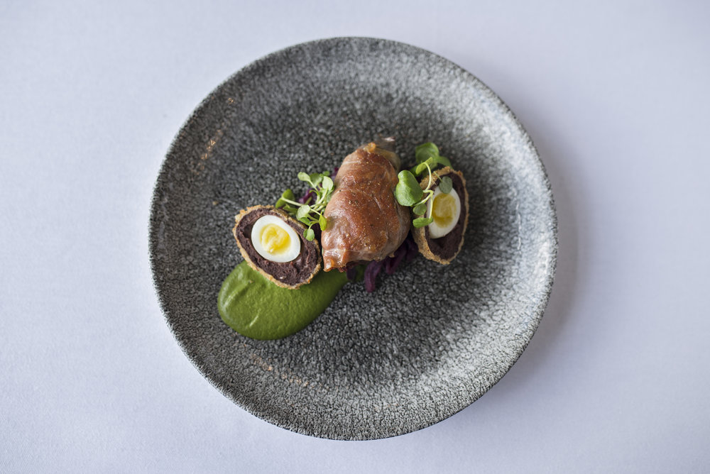 Seared wood pigeon breast, watercress puree, braised red cabbage and scotched quails egg.