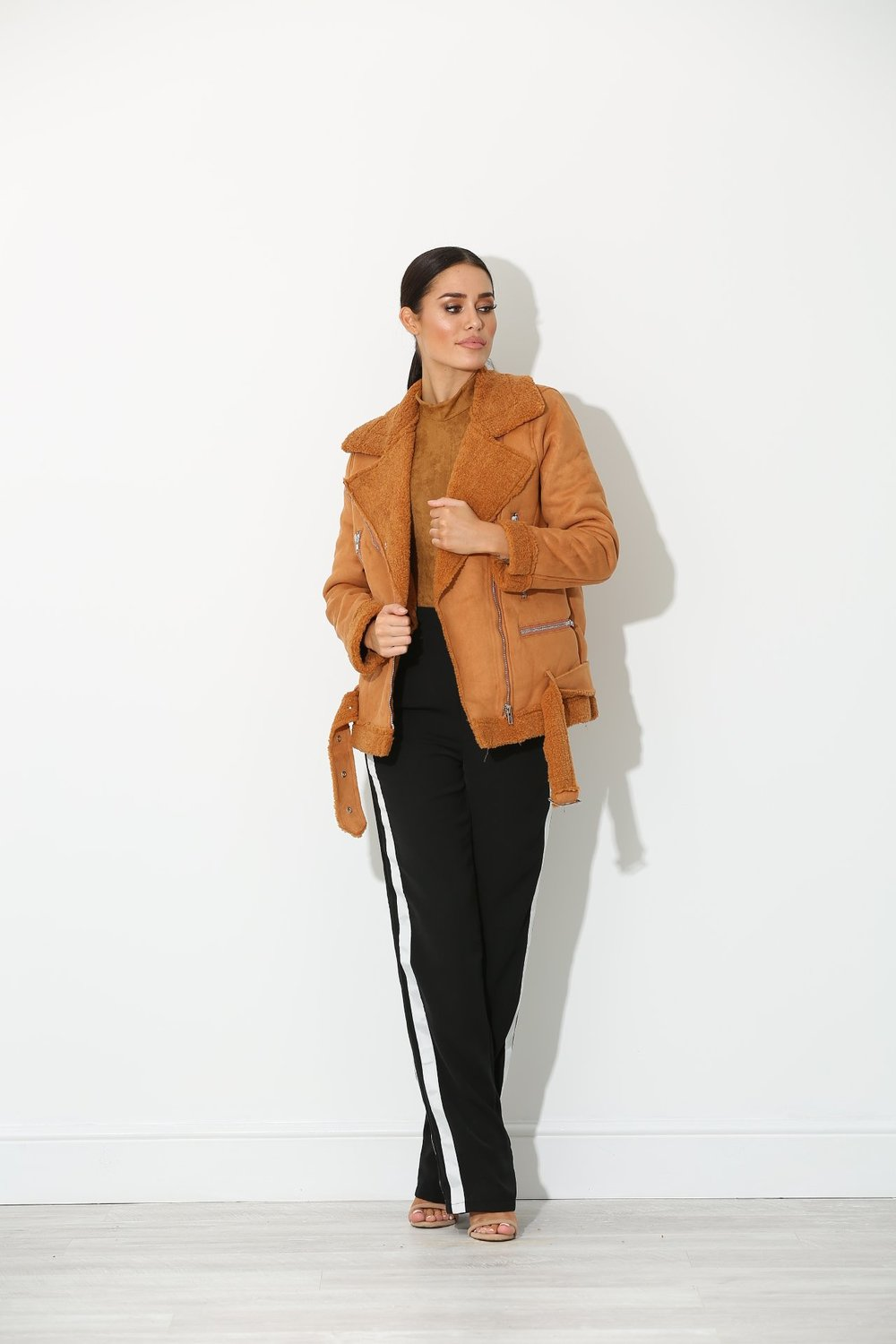 Shear is back  - This coat from the Marlowe line comes in a delicious camel colour and is paired with those iconic lines of the Rina Sports Luxe trousers.