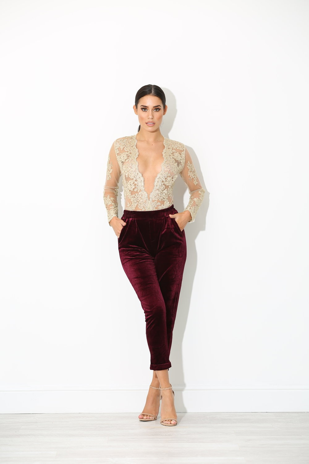 Refined Velvet - Sensual but stylish, a pair of Plum Liama trousers can be styled as a statement piece with an Eva Gold Lace bodysuit.