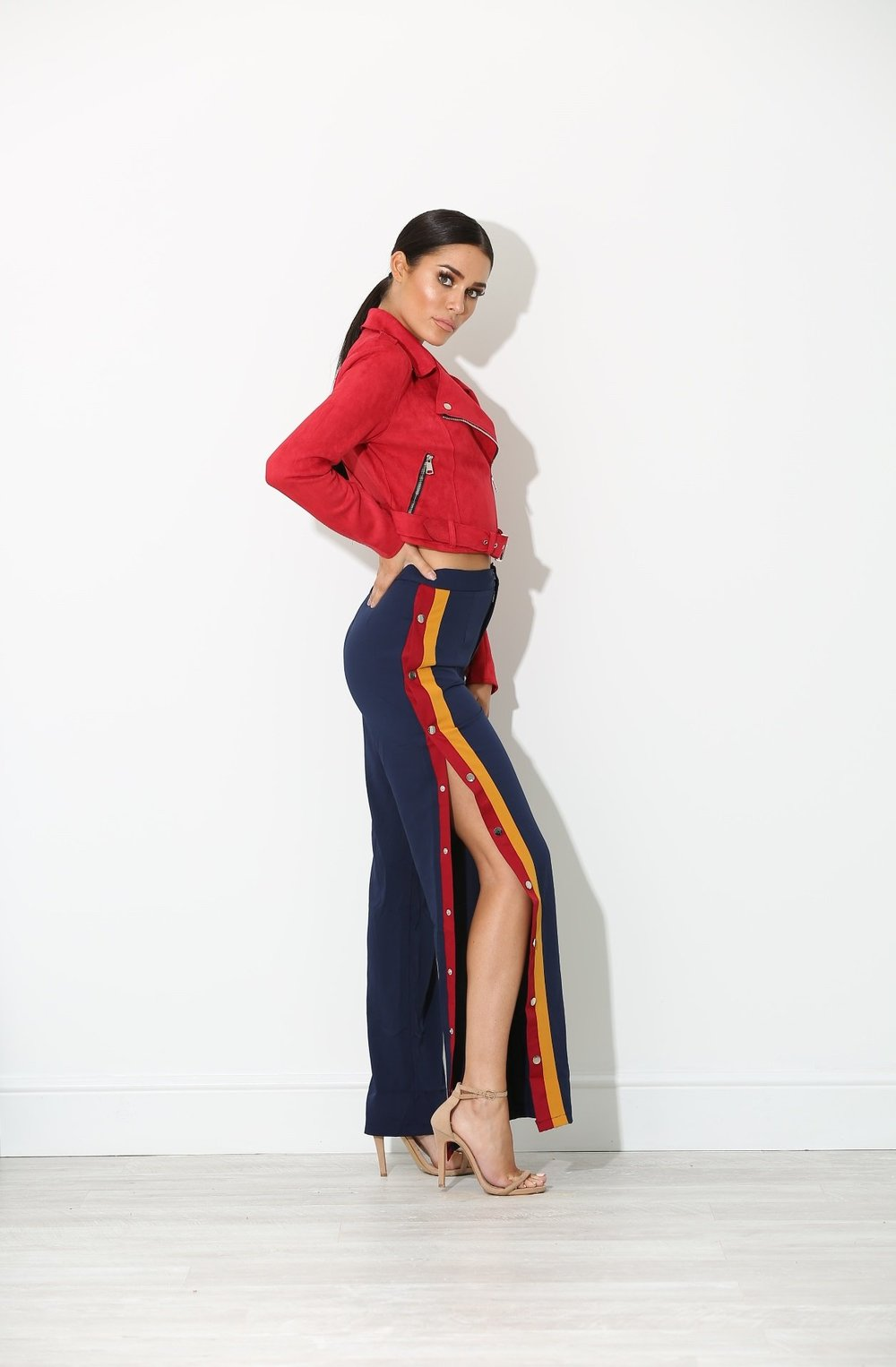 Sports Riche  - The popping colors of these sophisticated Jaja Luxe trousers couples nicely with the scarlet suede of this Enessa Biker jacket.