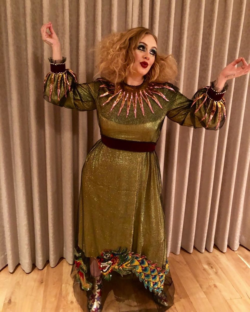 Dazzle Adele - Breaking her social media Hiatus, the Tottenham native showed off this shimmery Jester look.