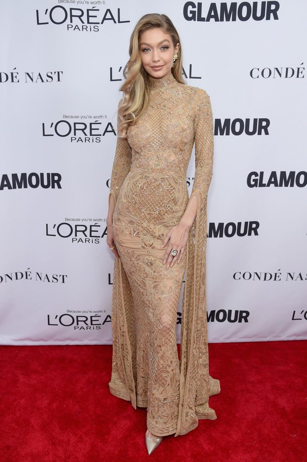 Gigi in Gold - The supermodel appeared in a stunning nude dress with gold embellishment. We're loving those sleeves too, you Supernova.