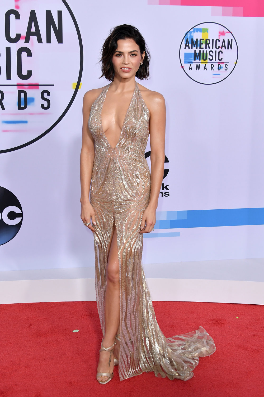 Champagne Tatum - Jenna Tatum dazzled with this flowing sparkly dress. That nude dress with shimmery embroidery was a standout at the awards show.