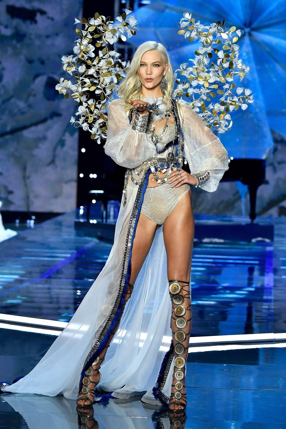 Karlie Kloss - After two years away, Kloss made her triumphant return to the runway. The sheer all-white look is accented so well by the silver and blue drapings.