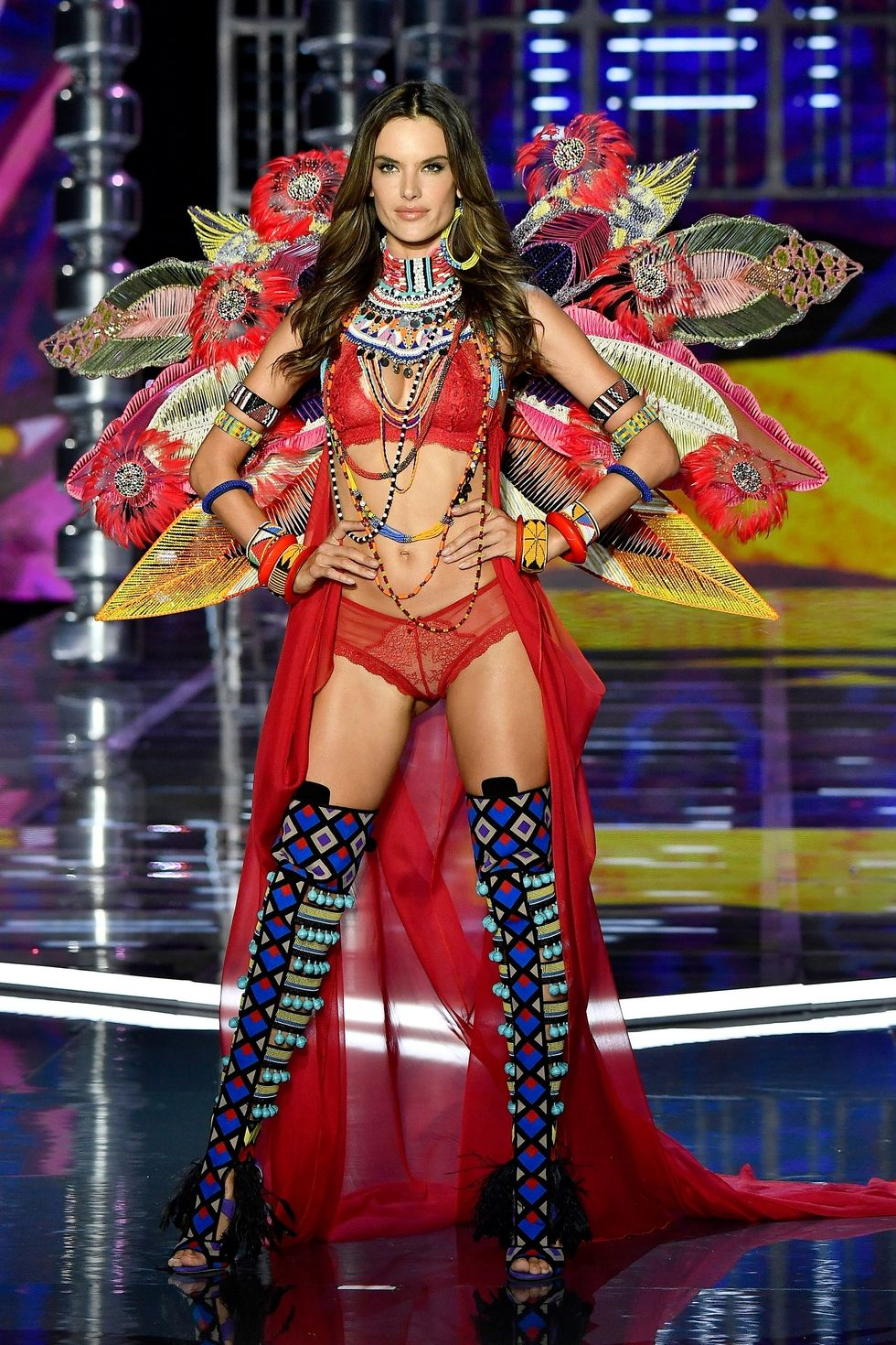 Alessandra Amrbosio - Pretty in Red, this Angel walked down with native inspired leggings and tribal patterned accessories. Exotic and hot.