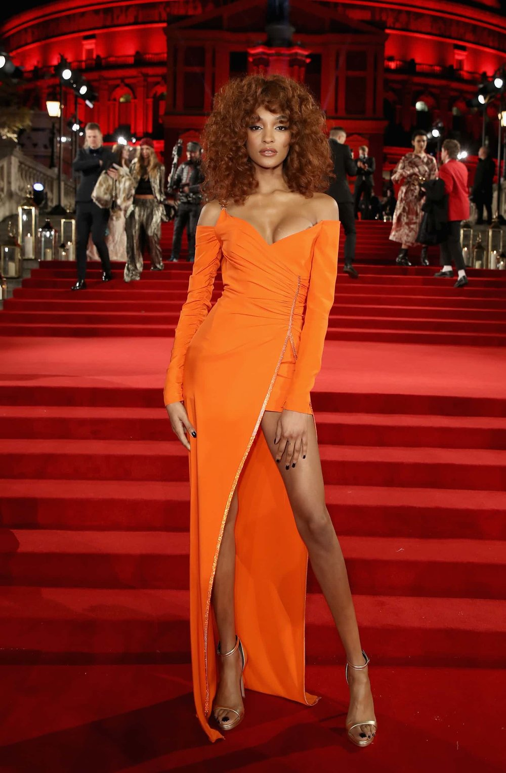 Jourdan in Orange - Dunn is looking amazing in this Versace dress, which is fitting since Donatella Versace won the fashion Icon award this year.