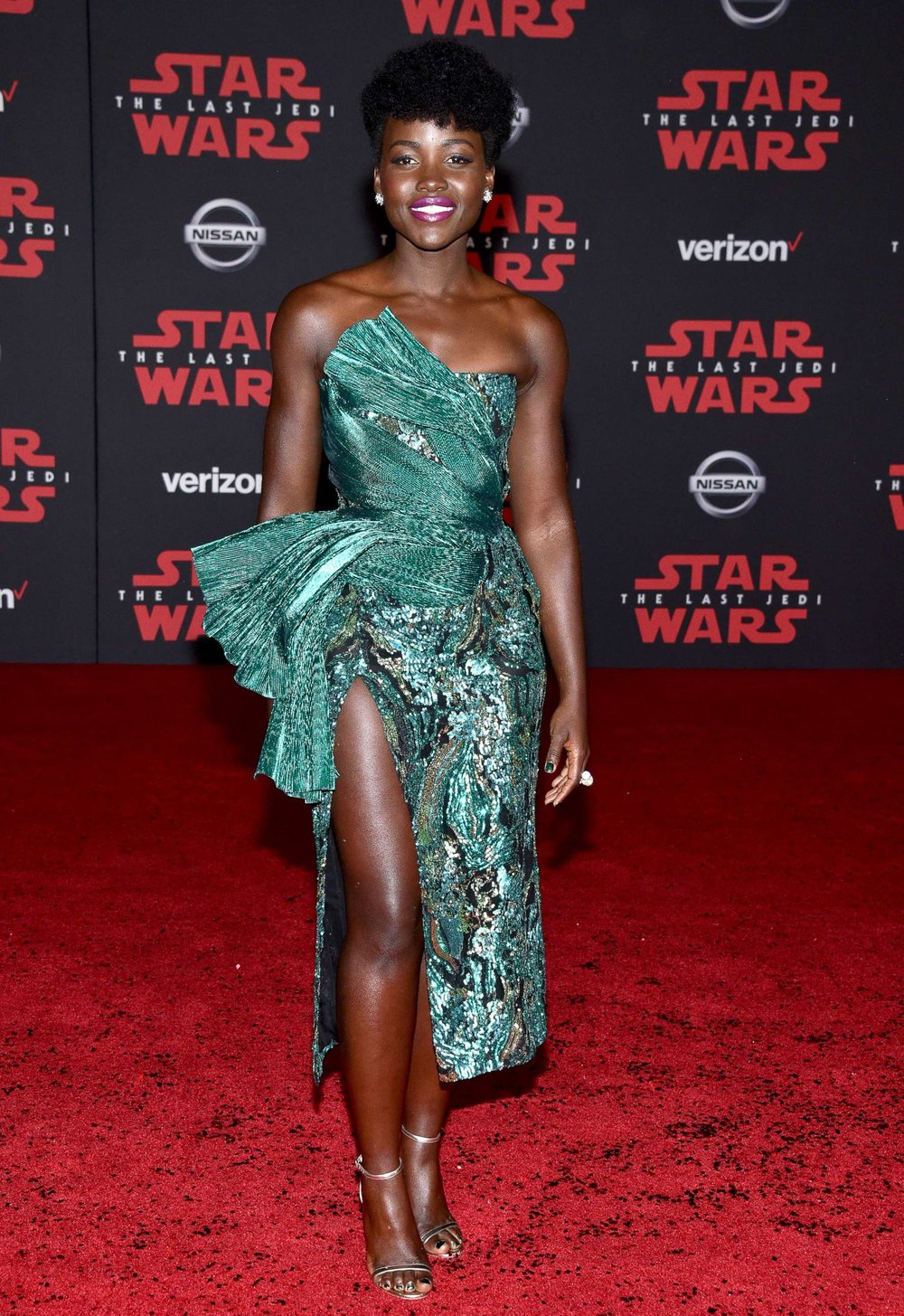 Lupita Nyong'o - Playing Maz Kanata, Lupita comes back for her second Star War in a beautiful emerald dress. That asymmetrical look shows off her leg beautiuflly.
