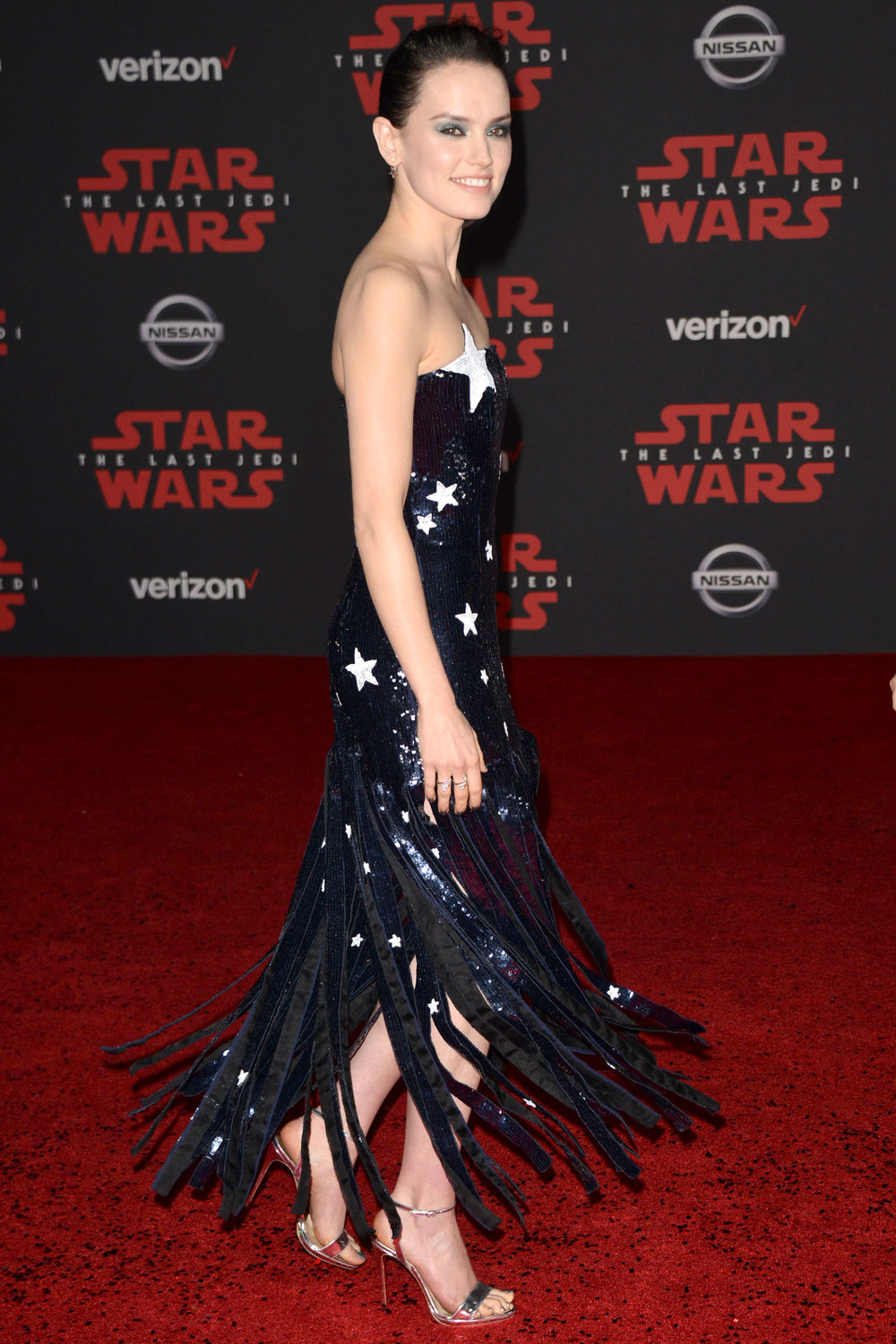Daisey Ridley - Starring in the role of Rey, Daisey came to the Star Wars Premiere covered in Stars. Did we mention Stars? The fringe bottom is quite mesmerizing.