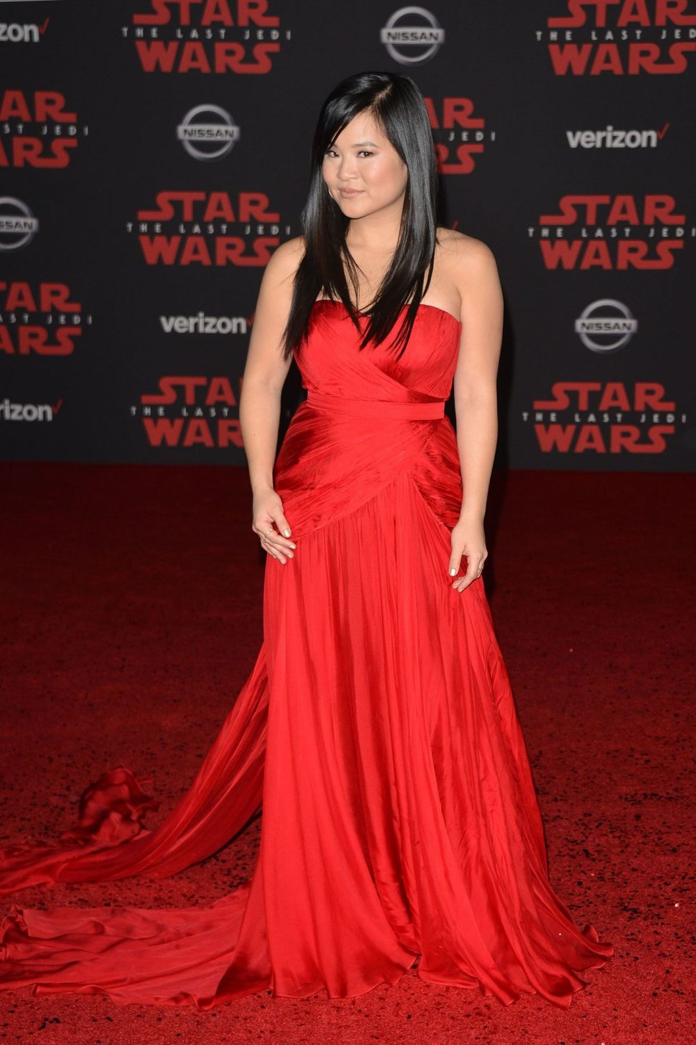 Kelly Marie Tran - Kelly is making her big-screen debut in a big way. Seen here being overwhelmed in a sweet moment with co-star Daisey Ridley, she wore this scarlett dress flowing behind her.