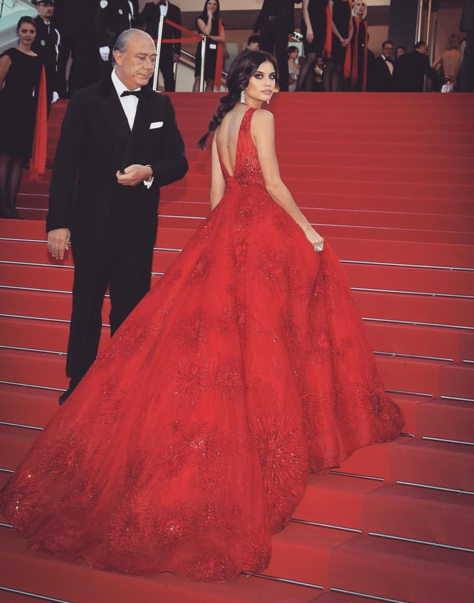 Sara Sampaio - The Victoria' Secret angel looked stunning in her crimson couture ball gown adorned with intricate thread embroidery by Zuhair Murad. As every Christmas red is the traditional colour, it represents love and warmth.