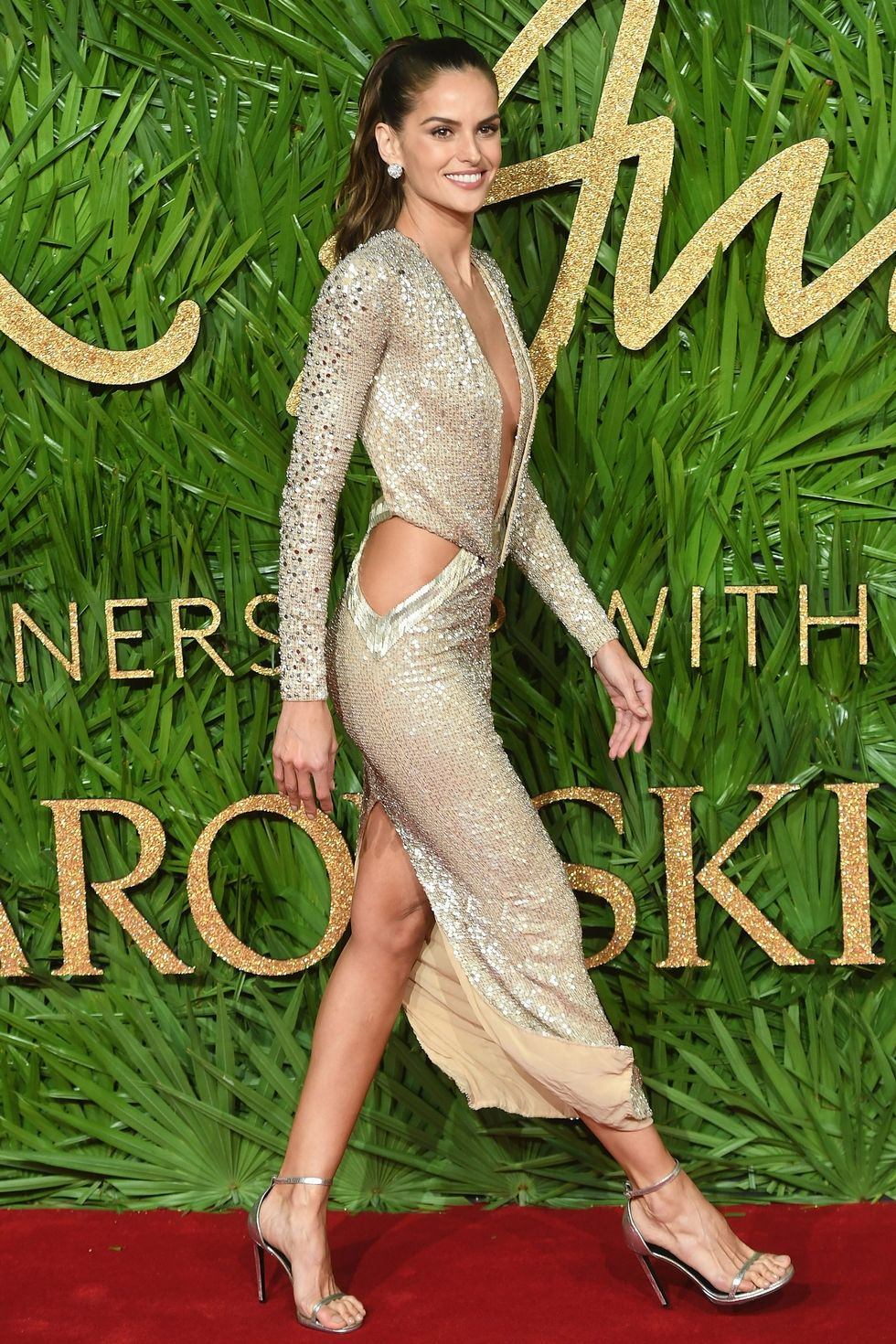 Izabel Goulart - The model was wearing a golden Julien Macdonald dress.Gold is a very trendy colour this season. It represents love, courage, magic and wisdom.