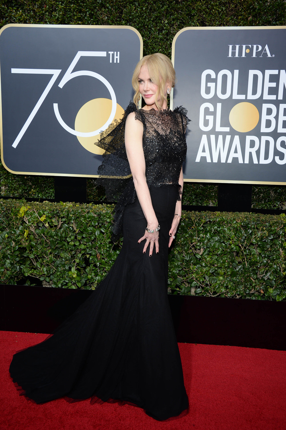 Nicole Kidman  - Wearing jaw-dropping black dress by Givenchy.