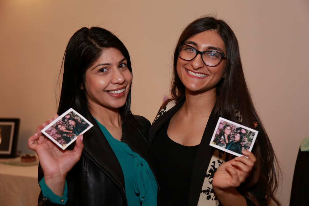 Event guests proudly showcasing their free photo magnets