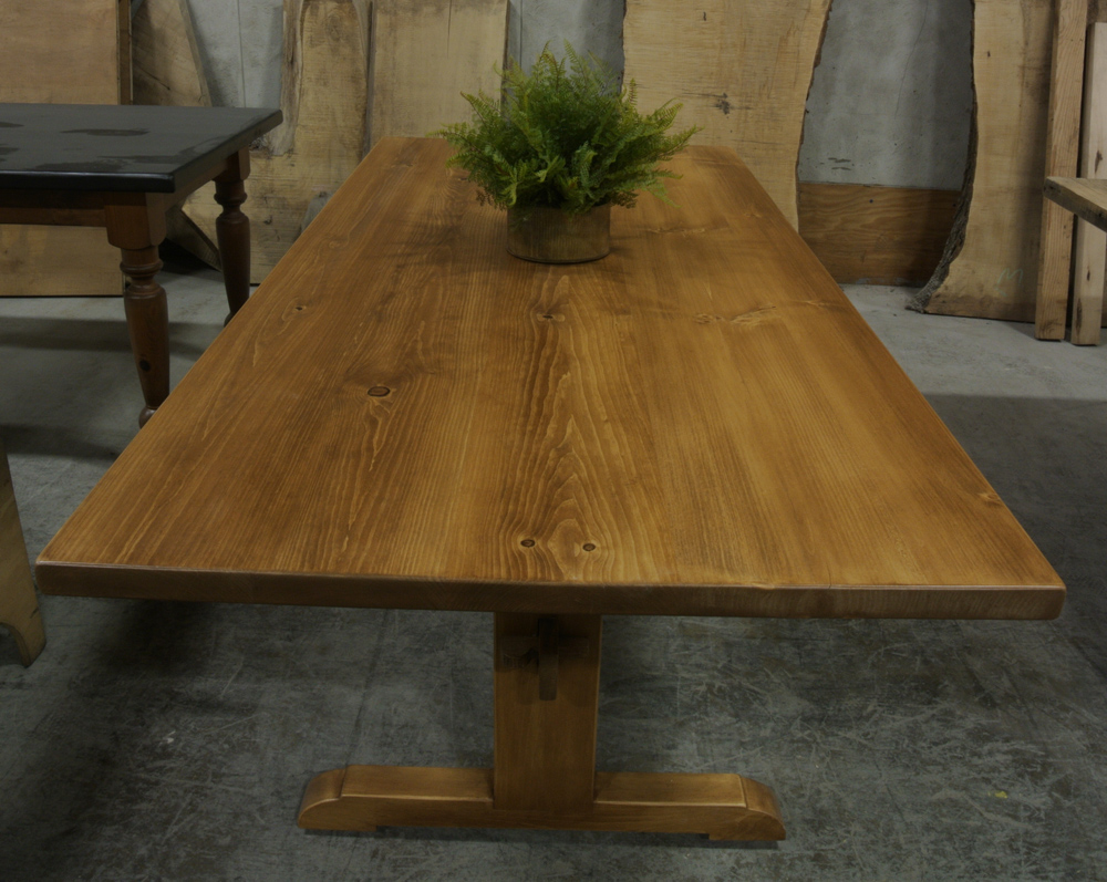Solid Pine Classic Trestle Table with a Light Early American Stain.