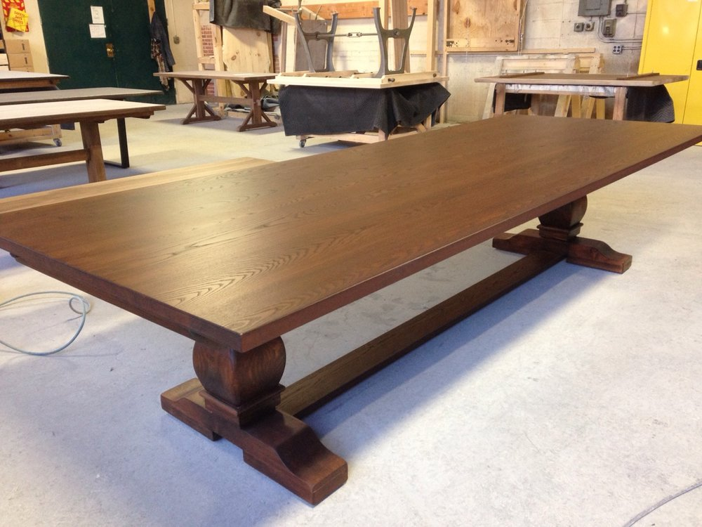 French Trestle Dining Table. Solid Ash with a Dark Spice Brown stain.