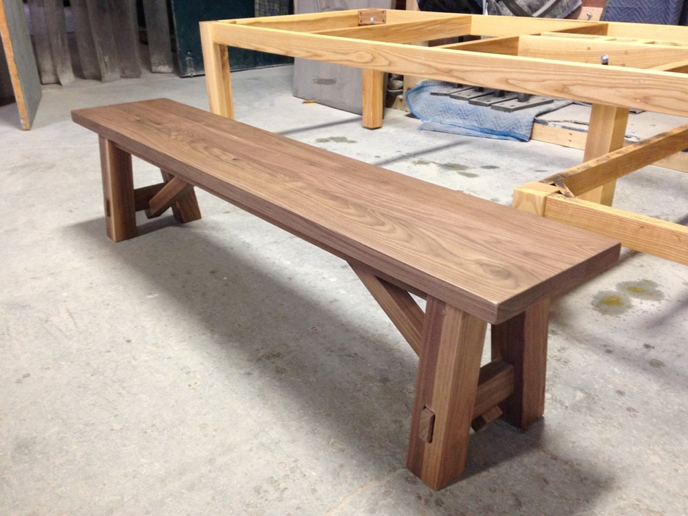 Solid Walnut Bench with a Custom Trestle Design.
