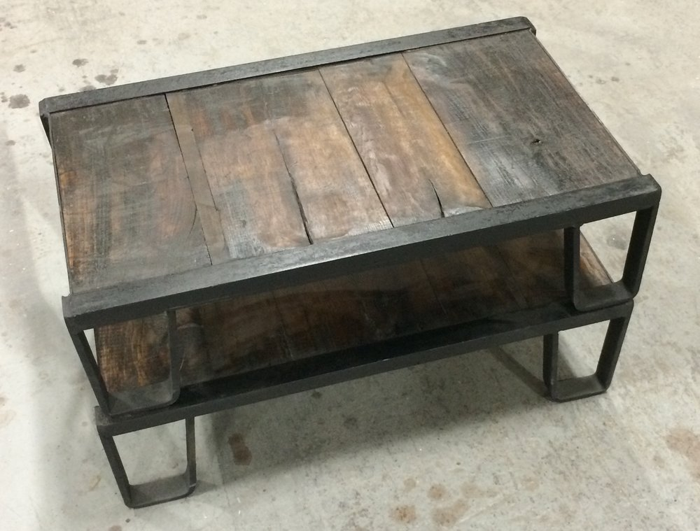 Antique Iron and Hardwood shipping pallets made into a unique coffee table