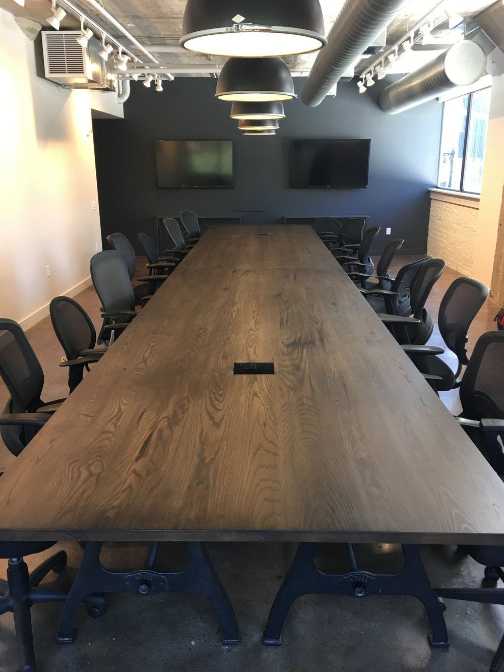 Incredibly long and wide conference table with Ash table top and Rhode Island cast iron machine legs