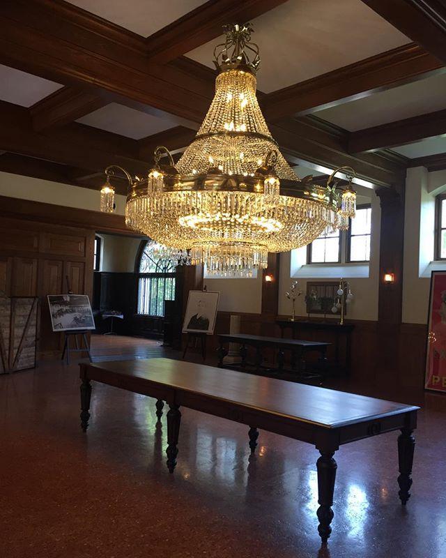 Sometimes even a 10' Walnut Table by the Lorimer Studios is dwarfed by the amazing antique chandelier at Belcourt in Newport #lighting #designer #rhodeisland #lorimerstudios #buylocalri