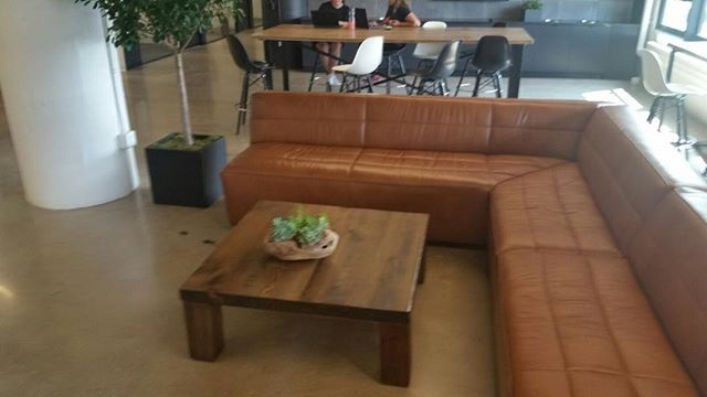 Comfortable salvaged lumber coffee table adds warmth to this workplace gathering corner #workplace #buylocal #officefurniture.