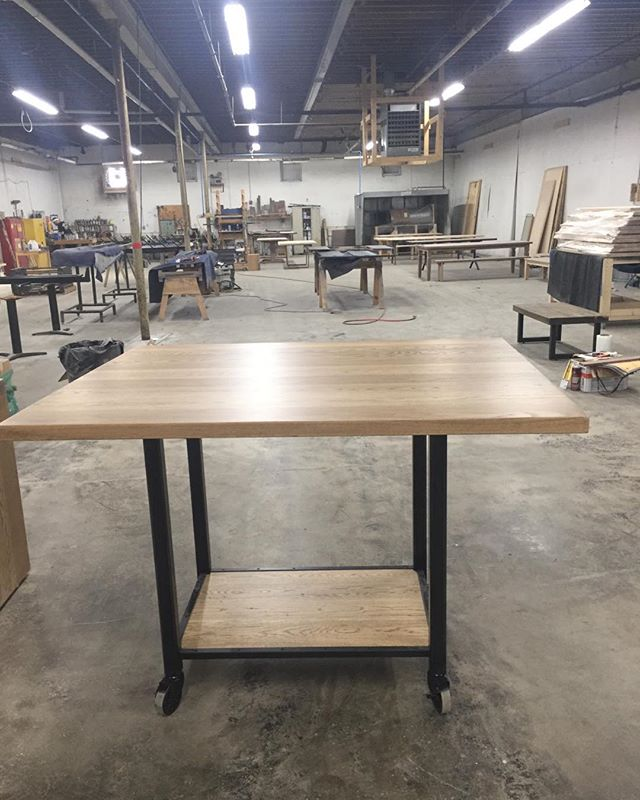 Solid White Oak work table with iron base and heavy duty casters