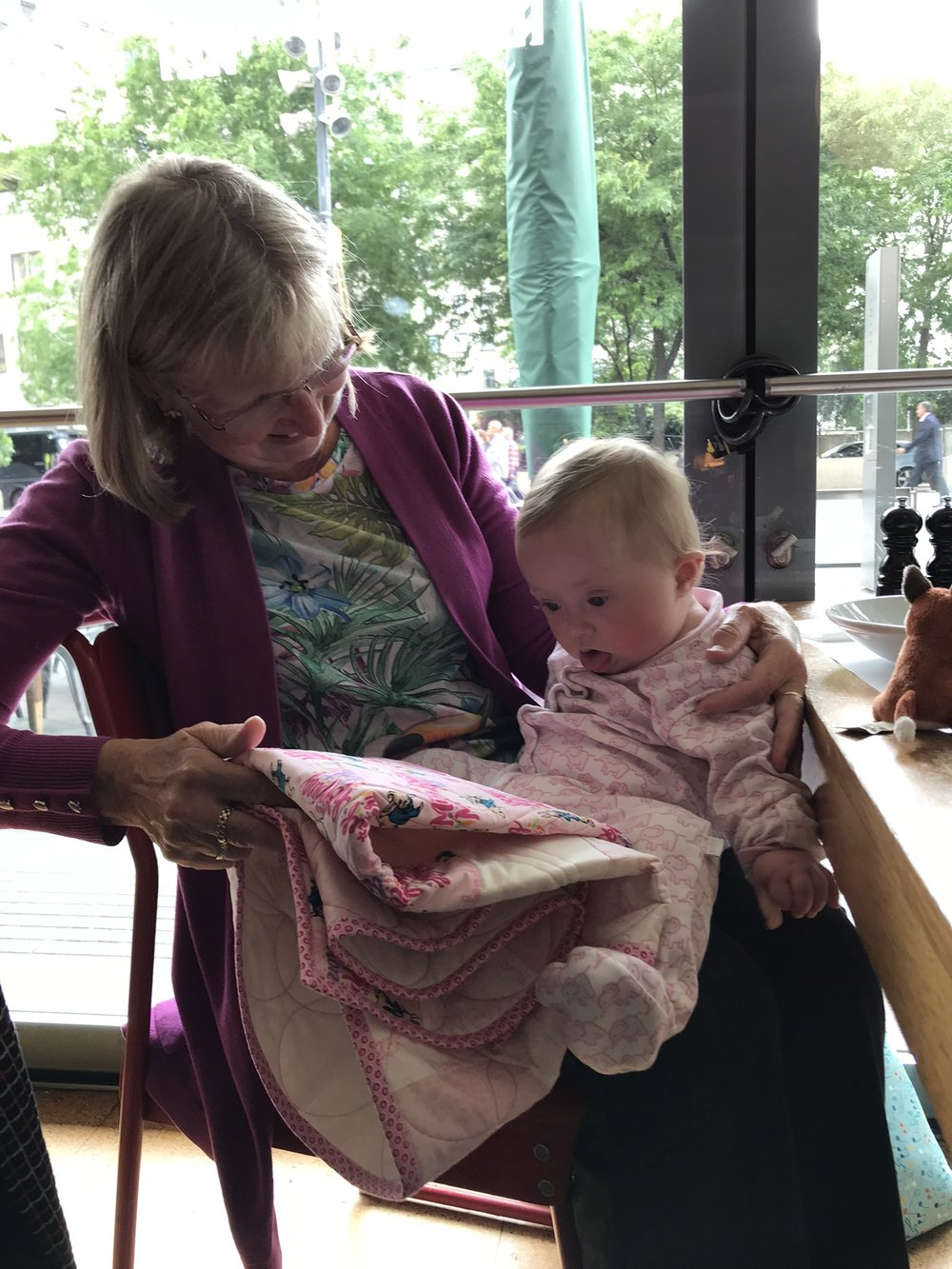 Val and Coraline in June 2018, with the quilt Val made her