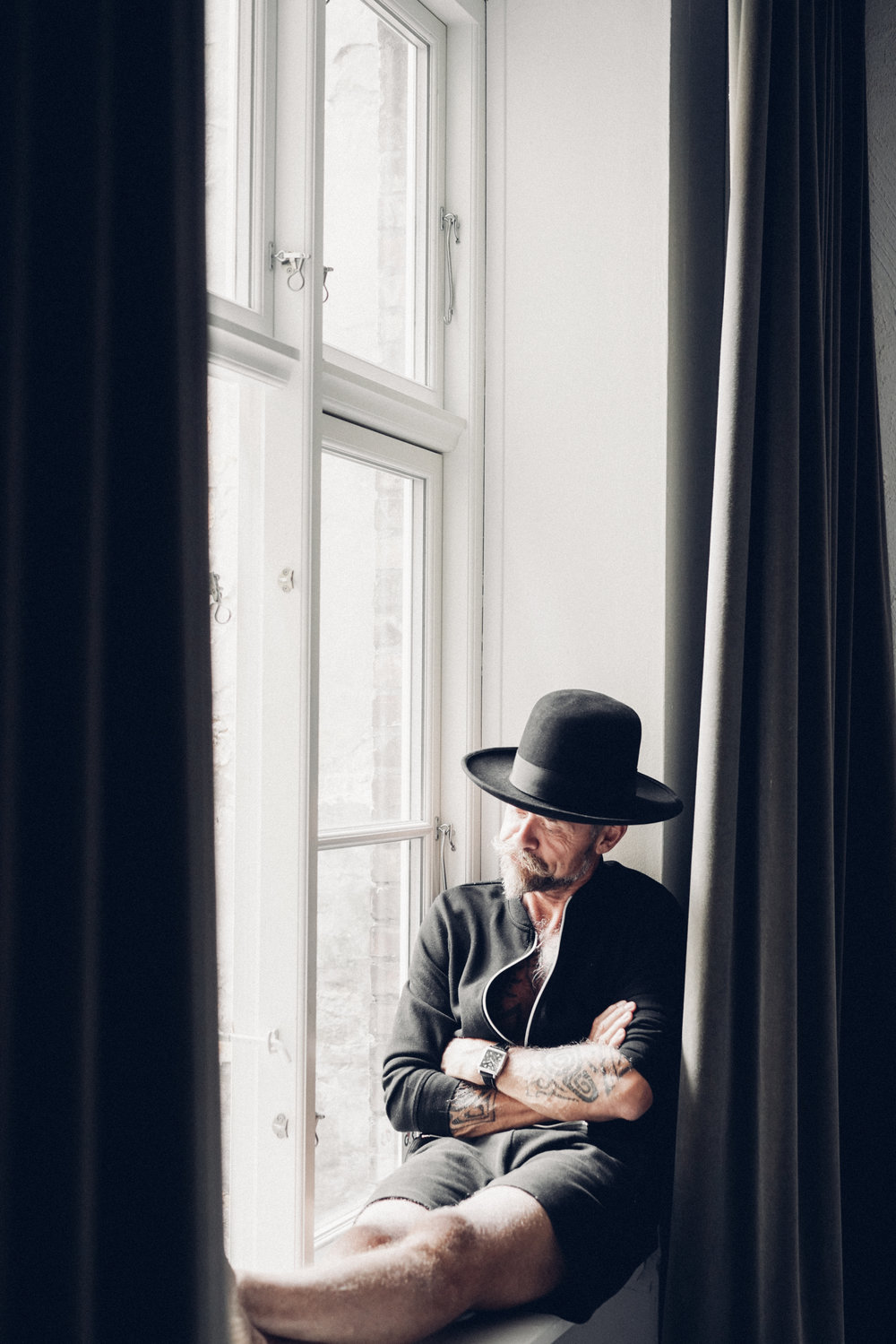 Morten Angelo sitting by the window