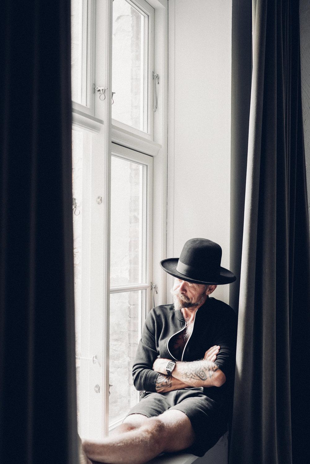 Morten Angelo sitting by the window