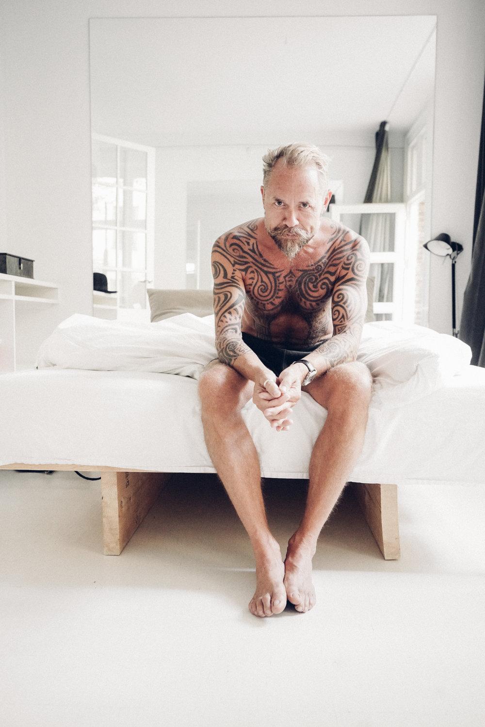 Morten Angelo sitting on bed