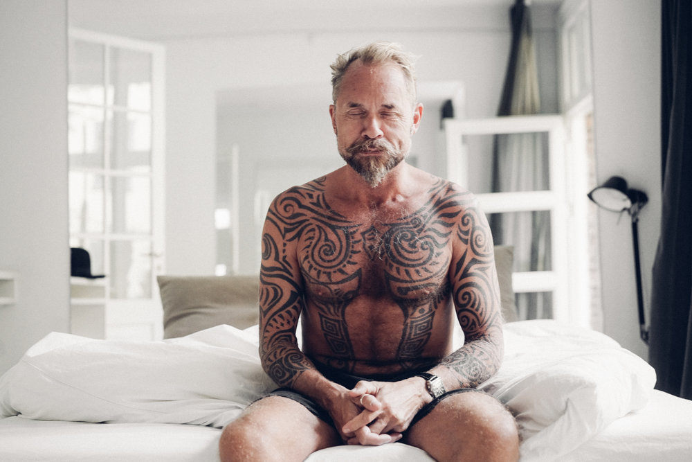 Morten Angelo sitting on the bed  with eyes closed