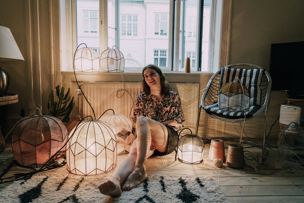 Alexandra Raben surrounded by her work