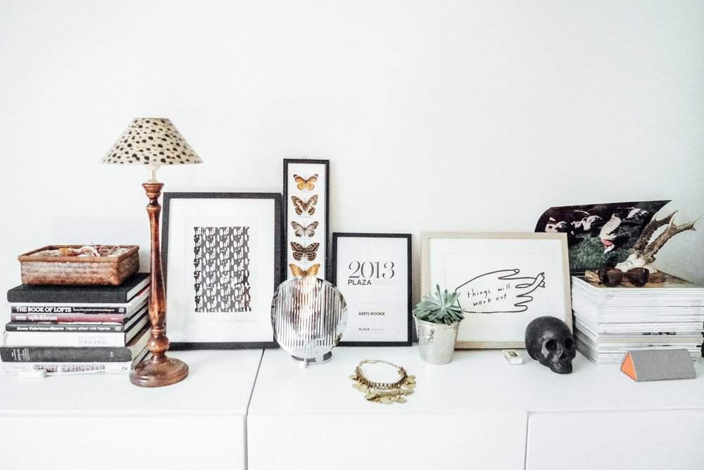 Alexandra Raben dresser with art, awards, and accessories