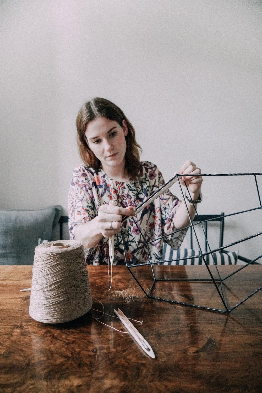 Alexandra Raben weaving a lamp