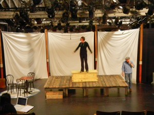 Set is now in progress, but not finished. Actors Mark Bramhall & Paige Lindsey White test out the spacing.