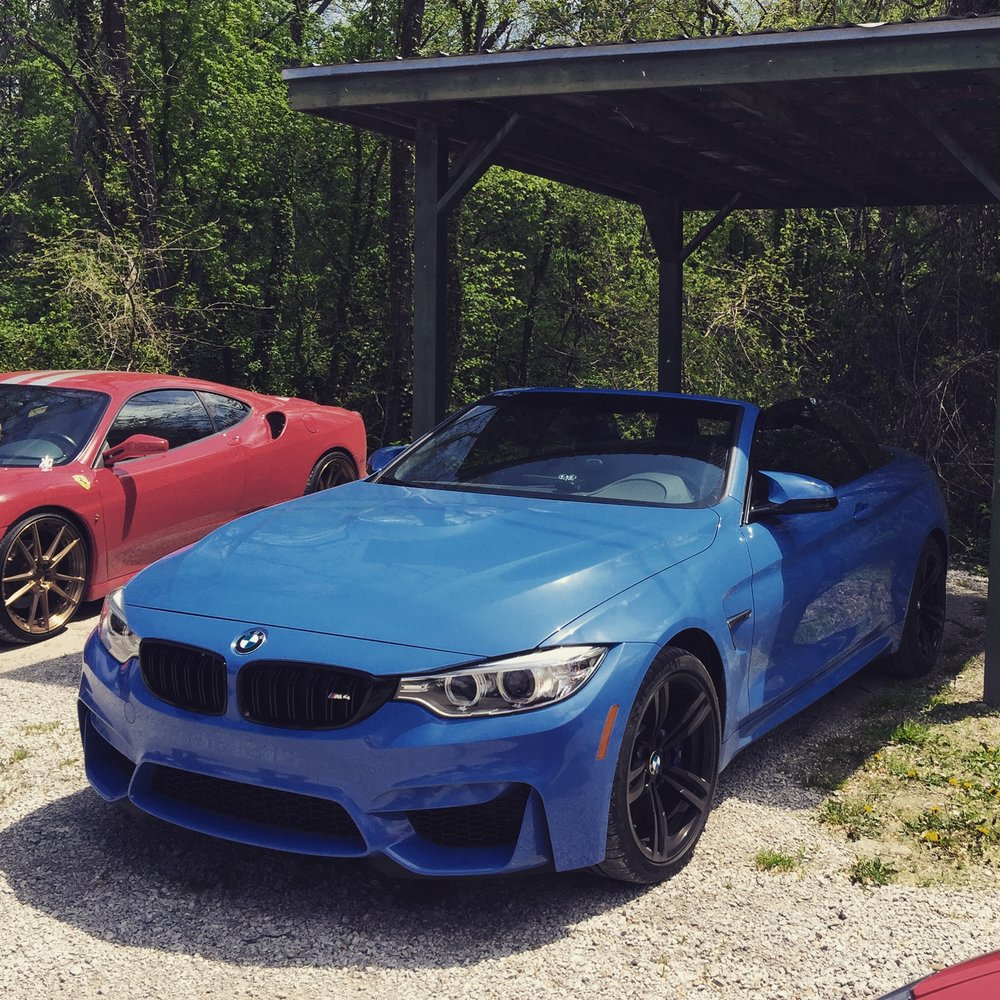 - I was driving my Christmas present, the day of the raid. The day I got her, she had a big red bow on the hood, displayed in the window at Baron BMW overlooking I-35. Yas Marina Blue, hard-top convertible, BMW M4, and a stick shift. Black leather interior with Yas Marina Blue stitching. Akrapovic aftermarket exhaust blaring, top down, right by the house. The big black SUVs. The cop cars. The agents walking around outside. The news van. Drove by them all, I wanted to see how bad it was. I kept driving, I was like nope, not ready.