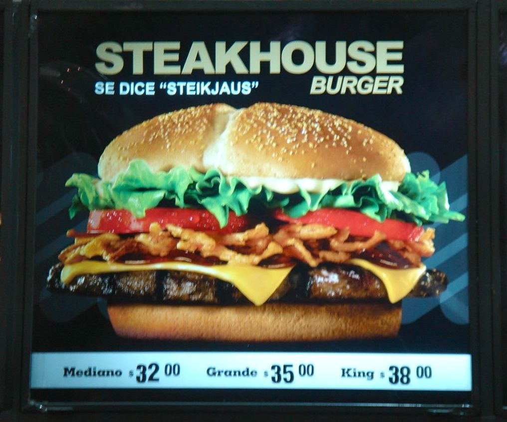 "Burger King's Steakhouse Burger was introduced to Argentina with this colorful advertisement, which included the pronunciation of ""Steakhouse"" and pricing in pesos. As Argentina is known for its beef, the content of the burger did not need to be adapted. (Photo: Madalena Sánchez Zampaulo, Buenos Aires, 2011)"