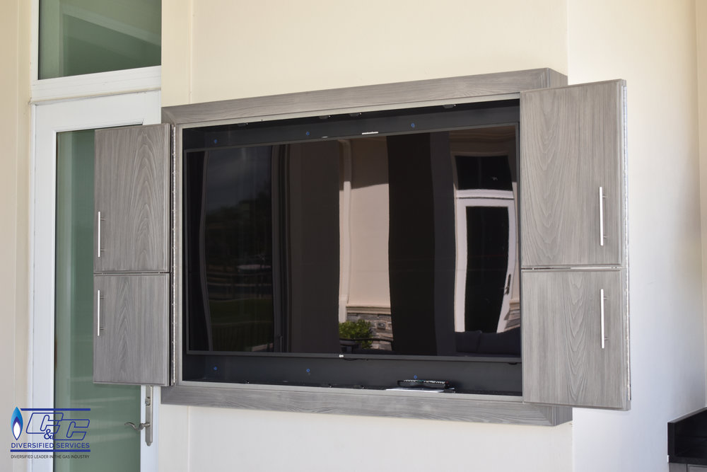 NatureKast Weatherproof Cabinetry in Fossil Gray Bi-fold TV Cabinet