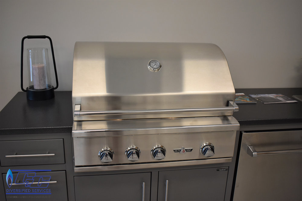 "Challenger Designs & Kitchen Custom Cabinetry Displayed with 32"" Delta Heat Gas Grill"