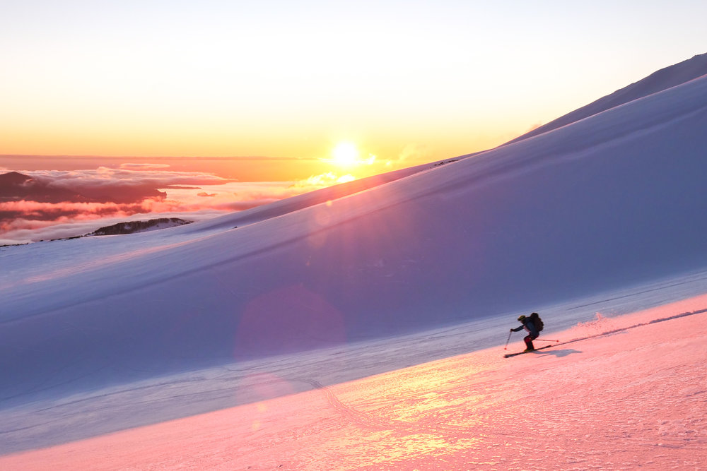 Hunter Markvoort making one last turn in the sun on our last run down the volcano.