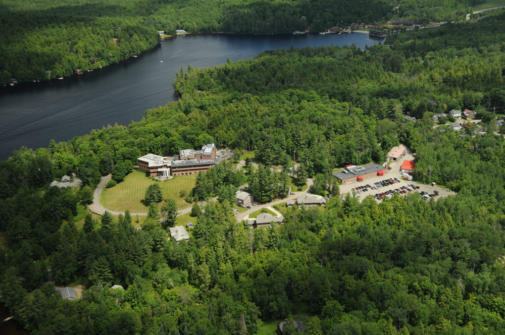 Campus - Trudeau Institute's main facility in Saranac Lake encompasses 42 acres and 90,000 square feet of research and support space, including specialized facilities for animal housing and biosafety containment work with newly expanded BSL3 and ABSL3 facilities. The research building was constructed in phases in 1963, 1998, and 2008. In addition to the main building, there is a maintenance shop, garage, daycare center, and 12 rental housing units.