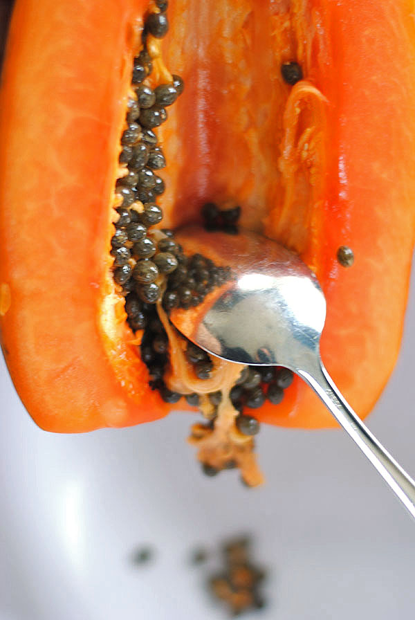 Cleaning a papaya.