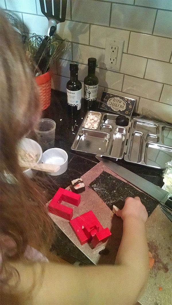 Rachael's daughter cutting sushi