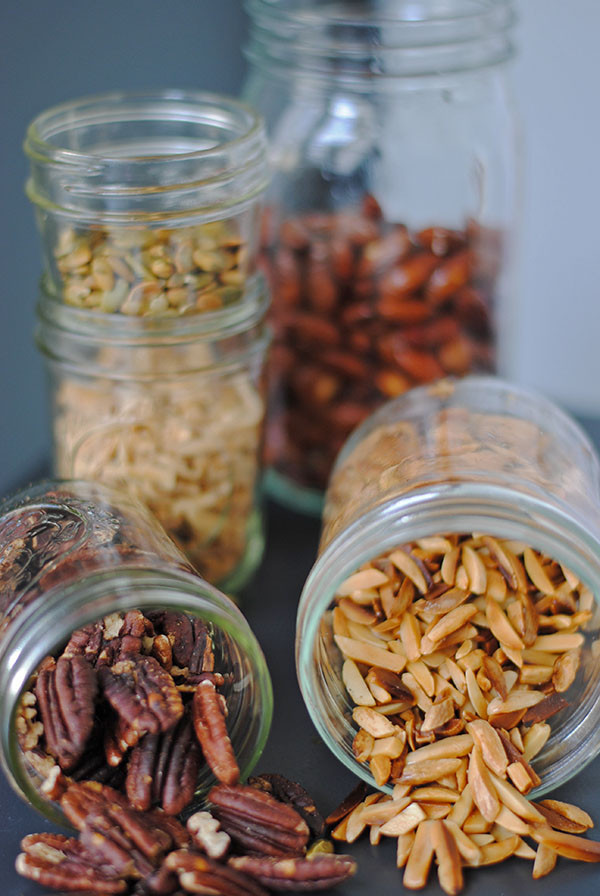 Starting with the front right and going left, clockwise: pan toasted slivered almonds in avocado oil, oven toasted pecans, oven toasted almonds (bottom), oven toasted pumpkin seeds, and honey orange almonds - recipe below!