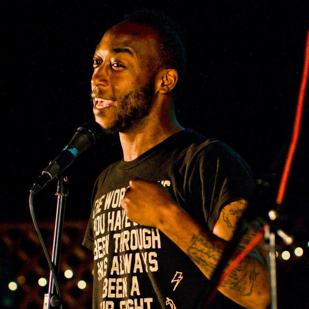 Dre aka Duke the Bossman - DRE aka DUKE THE BOSSMAN was born and raised in East Oakland, Ca. and is a graduate of Skyline High Schools. He started competing in poetry slam at the age of 14, with his first slam performance at Tourettes without Regrets. He competed in the Youth Speaks Slam until he found The Berkeley Poetry Slam. He started hosting the Berkeley Slam in 2007 where he meet producer Kelleth Chin who offered Duke a record deal. In 2008 his band The High Decibels placed #3 on CMJ top 200 Hip-Hop Charts. That gained the attention of Riptide Music Group in Hollywood, Ca who offered them an exclusive licensing deal. Since then Duke has had his music placed in blockbuster movies such as Ted, Cabin In The Woods, and Central Intelligence. His music has been placed in dozens of TV shows including Blunt Talk, Shameless, Broad City and many more. Currently Duke is a new father, releasing new music, and is a cast member of The Darling Clementines Burlesque show, Co-Founder of Digital Storytellers Non-Profit, Co-Producer/Host of The Oakland Poetry Slam and a member of the one and only Tourettes Without Regrets Crew. You can find his music on Itunes, Amazon, and Spotify. The High Decibels and his most recent album Color Me Black was produced by The Rondo Brothers of Handsome Boy Modeling School and Foster the People.
