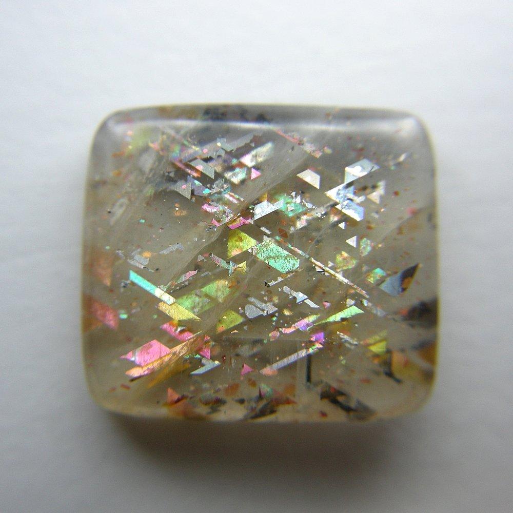 Iridescent Magnetite Laths in moonstone