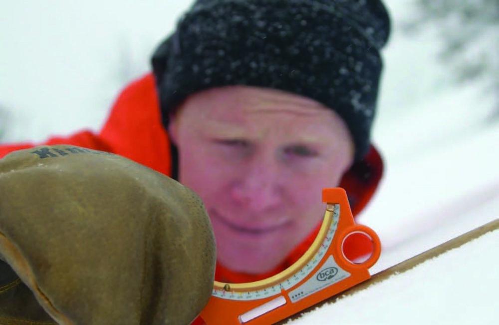 "Goertzen measures slope angle while filming, ""Send and Return: The BCA Safe Shredding Series"